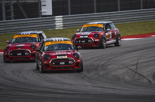 All three MINI John Cooper Works race cars turn a fast corner at Circuit of the Americas in Austin, Texas.  All three cars finished in the top 10 that day.