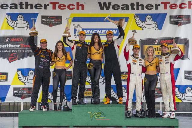 Mat Pombo (Left) & Derek Jones (Right) share the podium (Far Right Side) at Virginia International Raceway. The team drove the #73 MINI JCW to a third place finish that day.