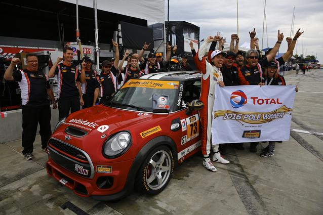 The MINI JCW team celebrates with driver Derek Jones, who took the pole position in the #73 MINI JCW at Watkins Glen International.