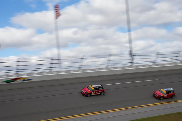 The #73 and #52 MINI JCW racecars run together on the high banks of Daytona International Speedway. Photo Credit: Images courtesy of the MINI JCW Race Team/LAP Motorsports LLC via Halston Pitman.